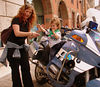 Bella, Bella! A typically beautiful Italian mother treats her son to the view from the seat of a  Bologna police BMW