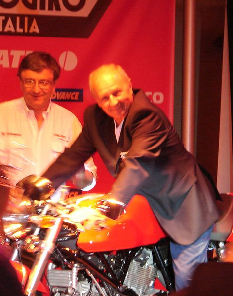 The winner! Angelo Spinelli checks out his prize while Ducati CEO Federico Minoli looks on.