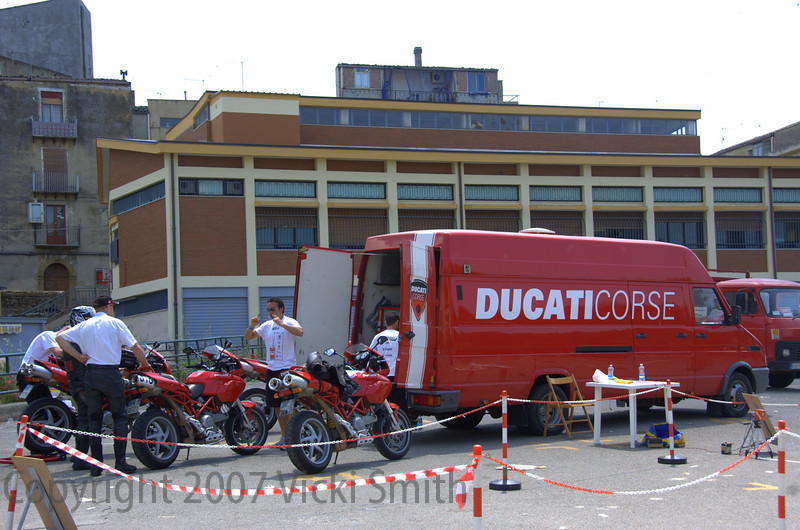 Ducati Corse services the press bikes and helps the modern bikes as well. One woman fell down on a Monster and while her tumble was minor the bike fell off the hill. These guys had it running in no time and she completed the day on time.
