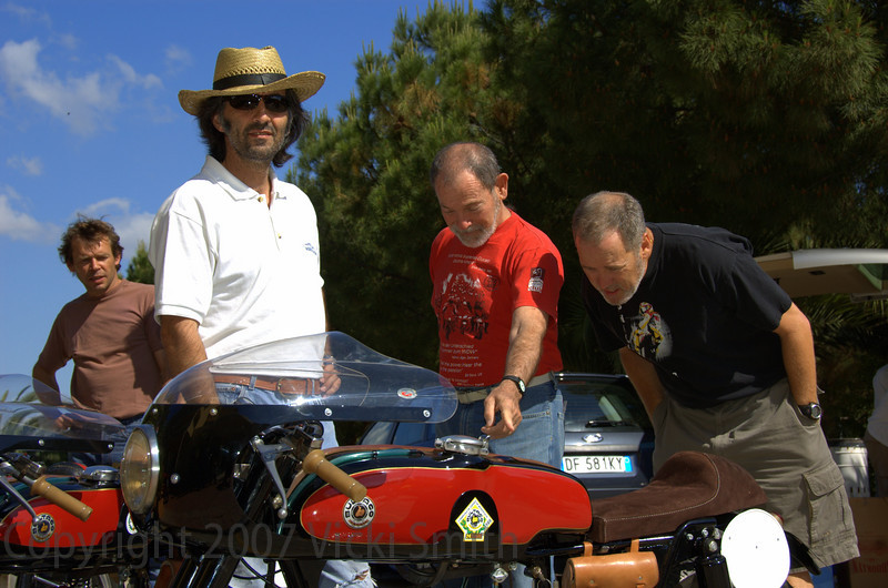 This photo is not posed. This is what happens every year when the bikes come out of the trailer - this year matched Bultaco TSS's. They drew a crowd the entire event.