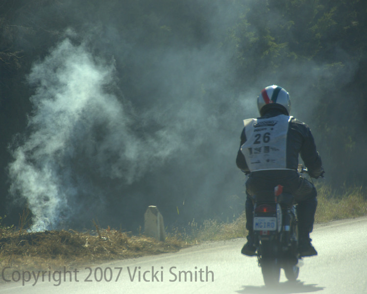Sicily is known for it's difficult route, the challenges make the event more satisfying in a way, and keep you on your toes. That's Rick Hammond from Canada riding past a brush fire.