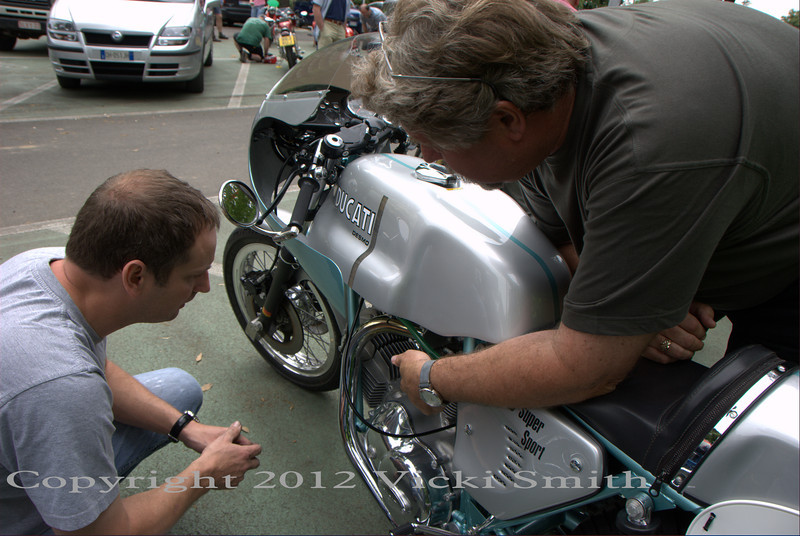 "That's Rich Lambrechts (this is his 4th 'giro) checking out Paul from Perth's immaculately restored ""Imola"" 1974 green frame Ducati. The story goes Paul bought the bike on eBay for in the neighborhood of $85,000 US, shipped the bike from America to Australia, restored it beautifully, not so easy given the price and availability of parts for these, then spent $9000 US each way to send it to Europe for the Motogiro and the Motoclub of Terni rally. It was a shining thing of beauty"