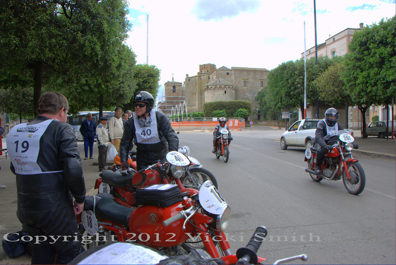 This day we were asked to wait in a town for a while so they could check the route - there had been a report somebody removed some arrows.  I suspect there was more too it since within a few moments there were people handing out local motoclub stickers and brochures about the town.  Tourism is serious business in Italy