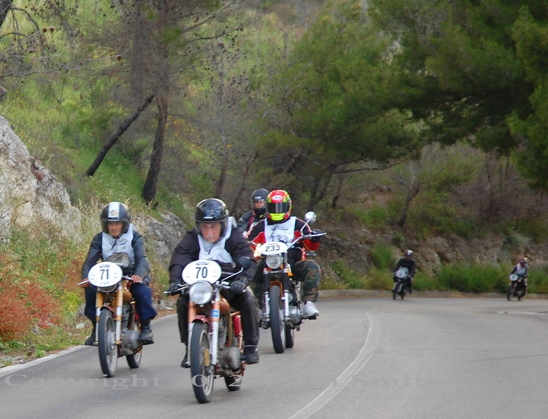 Often you find yourself riding in a big group of little bikes. It's the noise of that I love the best, the mix of the exhaust notes rattling off the mountains