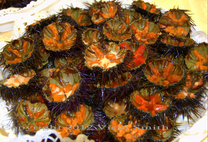 Fresh sea urchins. You scrape the orange part out and put it on crispy crust fresh bread. And yes, it really does taste like the sea.