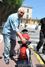 Giuliano Maoggi, 1956 Motogiro d'Italia winner and yearly regular, arrives in Cannes and picks up his bike for the 2010 event