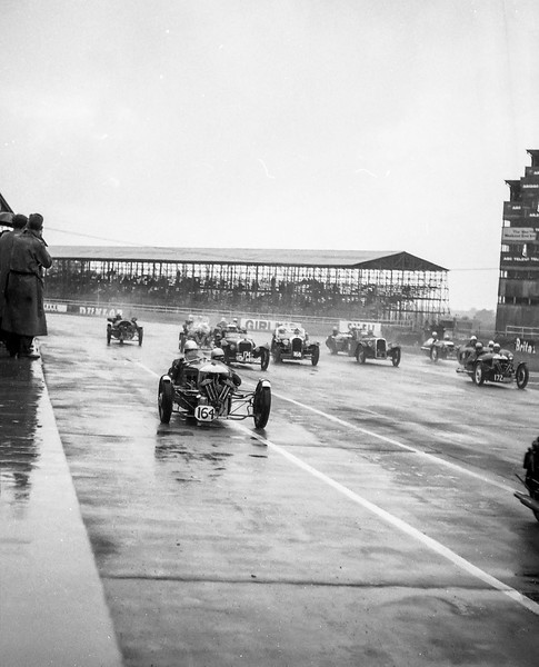 Start of a wet race for three-wheelers, Silverstone, about 1963