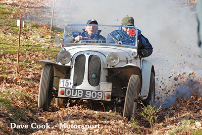 David Bache in a 1600cc Dellow, clears some of the leaves