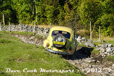 No. 115 Michael Leete and Mike Hayward, Class 4, 1285cc VW Beetle, Michael get thrown sideways by the rough track.