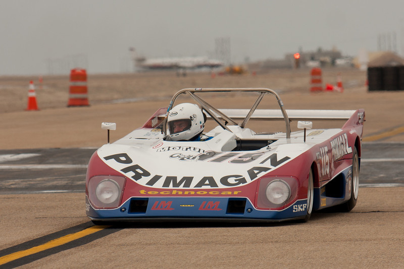 Cal Meeker has his eyes on the mirror of his 1973 Lola T-294.