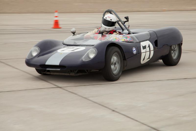 Donald Stark and his 1964 Lotus 23B as he enters turn ten.