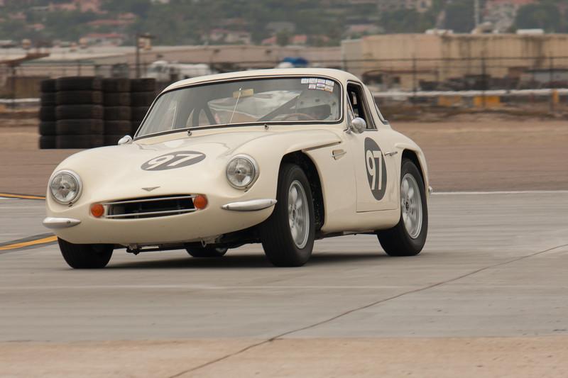 Hal Monheim leans his 1962 TVR Grantura MK3 out of turn ten.