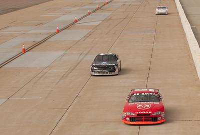 NASCAR thunder on the front straight.