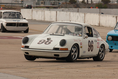 Ed Matsuishi lifts the right front wheel of his 1965 Porsche 911.