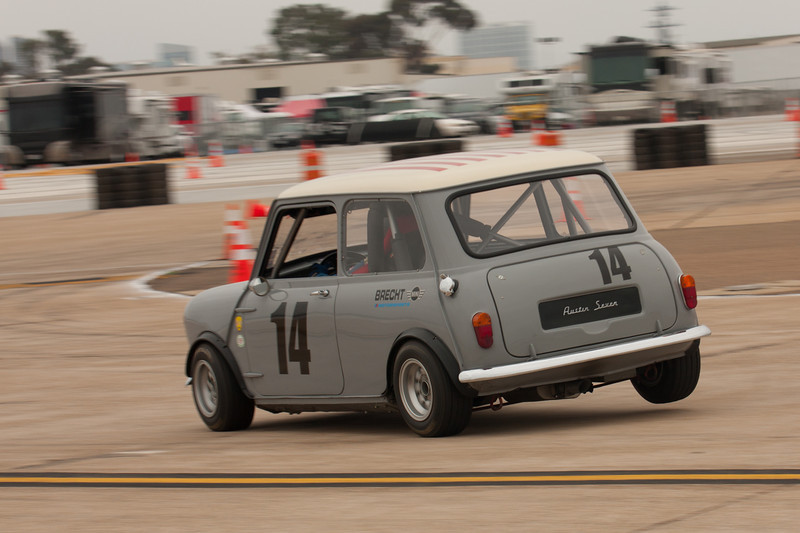 Tim Brecht lifts the right rear tire of his 1960Austin Mini Cooper S, as he enters turn six.