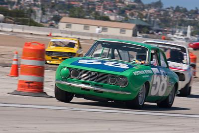 Jon Norman exits turn 9 in his 1971 Alfa Romeo GTV. © 2014 Victor Varela