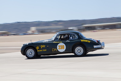 Al Waterhouse in his 1958 Jaguar XK150. © 2014 Victor Varela