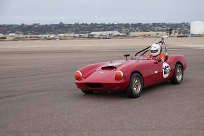 Ken Pien enters turn 10 in his 1963 Elva Courier. © 2014 Victor Varela