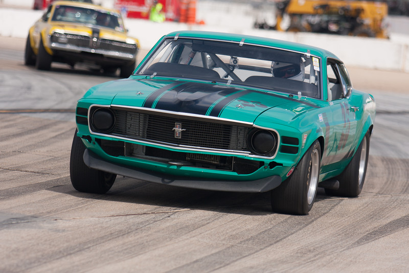 Craig Conley exits turn 11 in his 1970 Ford Boss 302 Mustang. © 2014 Victor Varela
