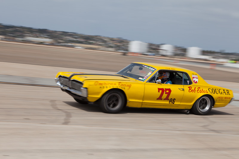 Jim Francies powers out of turn 11 in his 1967 Mercury Cougar. © 2014 Victor Varela