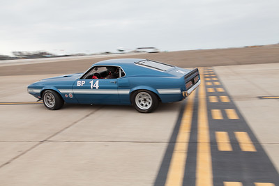 Andrew Alcazar in his 1969 Ford Boss 302 Mustang. © 2014 Victor Varela