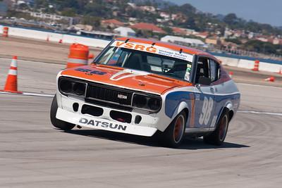 Jonathan Ornstein exits turn 9 in his 1973 Datsun 710. © 2014 Victor Varela