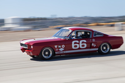 Mark Cane races towards turn 10 in his 1966 Shelby Mustang GT 350. © 2014 Victor Varela