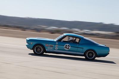 Bob Paris exits turn 11 in his 1966 Ford Mustang. © 2014 Victor Varela