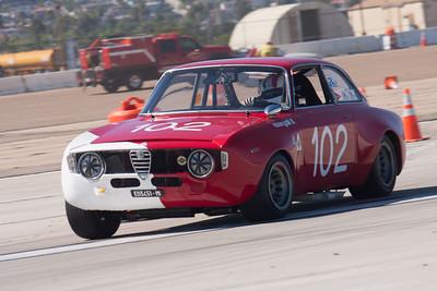 Brandon Adrian powers out of turn 9 in his 1967 Alfa Romer GTA. © 2014 Victor Varela