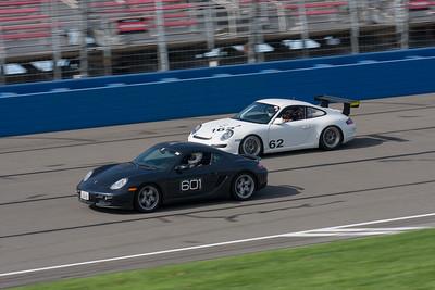 2007 Porsche Cayman leads a 2008 Porsche  GT3 Cup