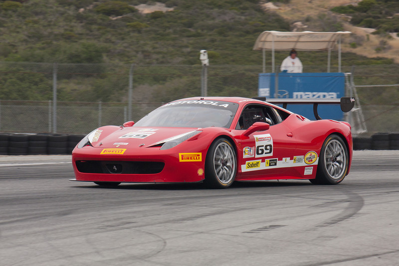 Michael Macs exits  turn 11 and onto the front straight in the #69 Ferrari 458 EVO. © 2014 Victor Varela