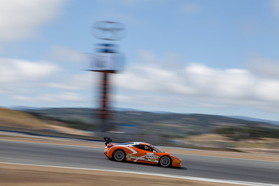 Robert Herjavec rounds turn ten in the #077 Ferrari 458 EVO. © 2014 Victor Varela