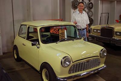 Gary towering over a 1981 Austin Mini. This particular car has been somewhat modified from the original, but it's essential smallness is still easy to see. KC Classic Auto, Lenexa, Kansas.