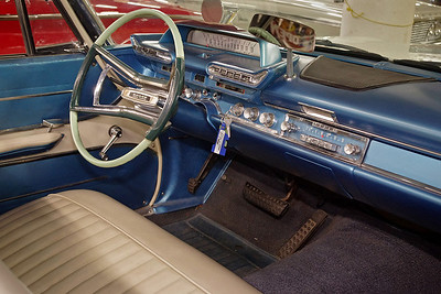 This 1961 Dodge convertable offers a roomy front seat and a technologically advanced dashboard console. KC Classic Auto, Lenexa, Kansas.