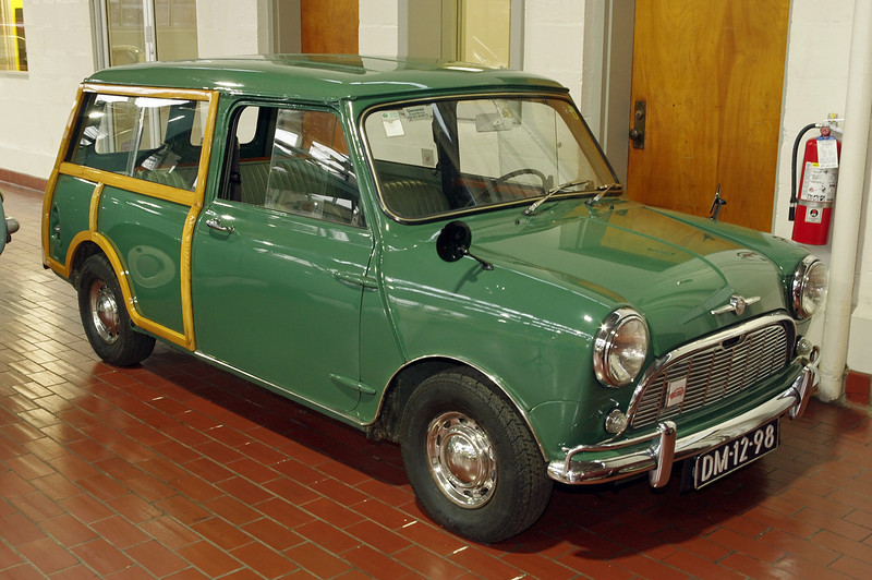 "1967 Morris Mini-Minor Traveller. Lane Motor Museum, Nashville, Tennessee. <br /> <br /> From their website:<br /> In the 1950s, Morris merged with its old rival Austin to form British Motor Corp. Economic factors in the UK in the mid-1950s made the creation of ""a proper miniature car"" a priority, and BMC assigned a small team of designers to the task. Alec Issigonis led the design team. Mini was introduced in 1959, to wild acclaim. The popularity of the Mini spawned many models that targeted different markets. The Mini Traveller, a two door station wagon with double ""barn-door"" style rear doors, was designed for carrying. The luxury model you see here has wood inserts in the rear body. This left-hand drive Mini was designed for export."
