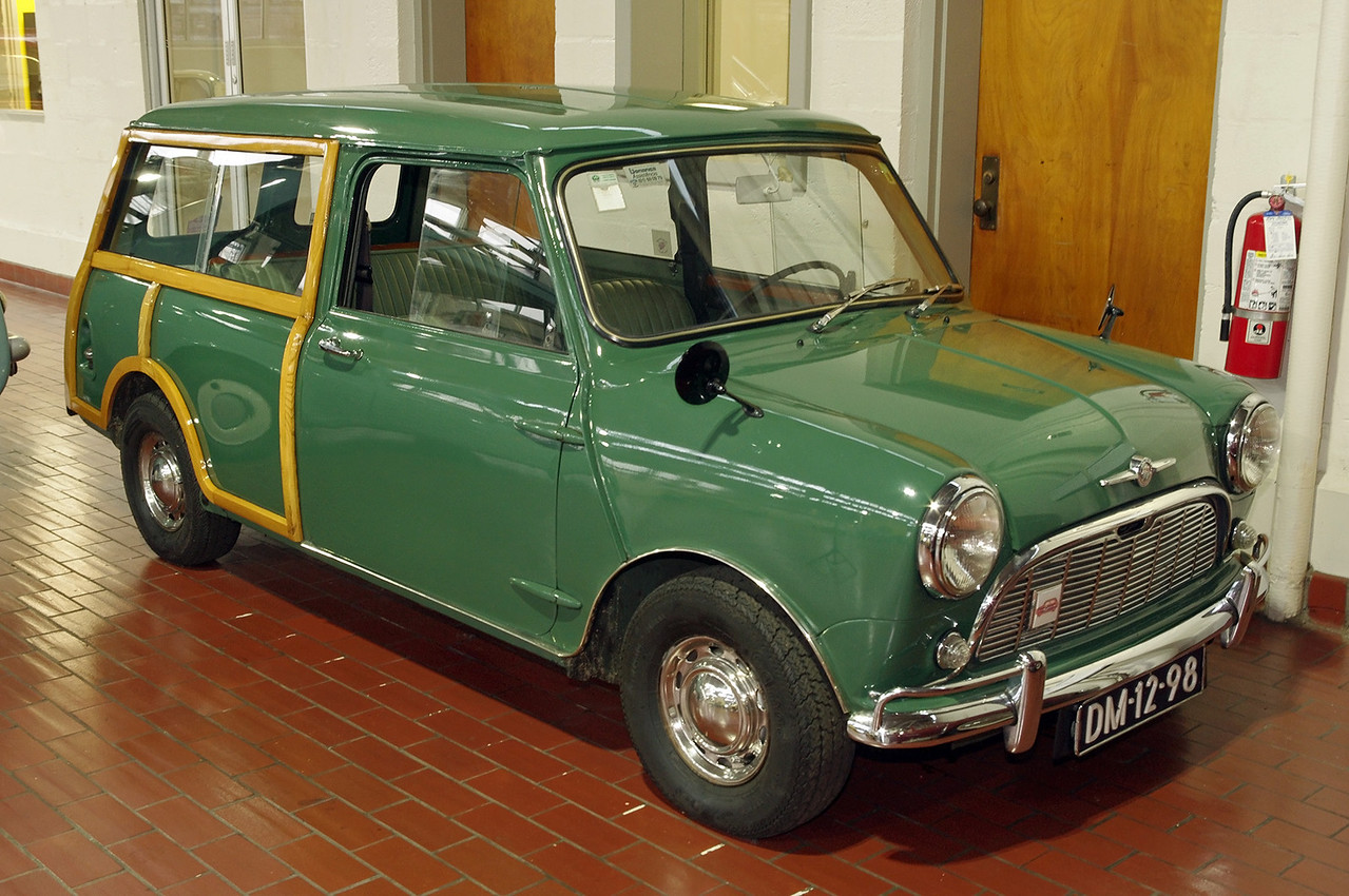 """1967 Morris Mini-Minor Traveller. Lane Motor Museum, Nashville, Tennessee. <br /> <br /> From their website:<br /> In the 1950s, Morris merged with its old rival Austin to form British Motor Corp. Economic factors in the UK in the mid-1950s made the creation of """"a proper miniature car"""" a priority, and BMC assigned a small team of designers to the task. Alec Issigonis led the design team. Mini was introduced in 1959, to wild acclaim. The popularity of the Mini spawned many models that targeted different markets. The Mini Traveller, a two door station wagon with double """"barn-door"""" style rear doors, was designed for carrying. The luxury model you see here has wood inserts in the rear body. This left-hand drive Mini was designed for export."""