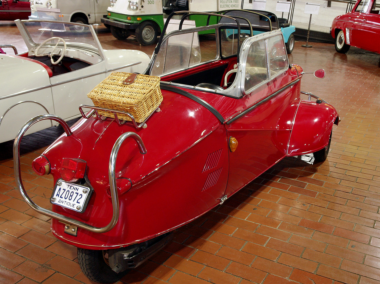 """1957 Messerschmitt KR200, rear view; Lane Motor Museum, Nashville, Tennessee. From their website:<br /> """"Although it bears the name of the famous aircraft builder–Willy Messerschmitt–he had little to do with the car's design. Fritz Fend designed the car, and it was built at Messerschmitt's factory which was restricted from building airplanes after World War II. This car appealed to motorcyclists who wanted more weatherproof transportation and to customers who found it cost half the price of a Volkswagen."""""""