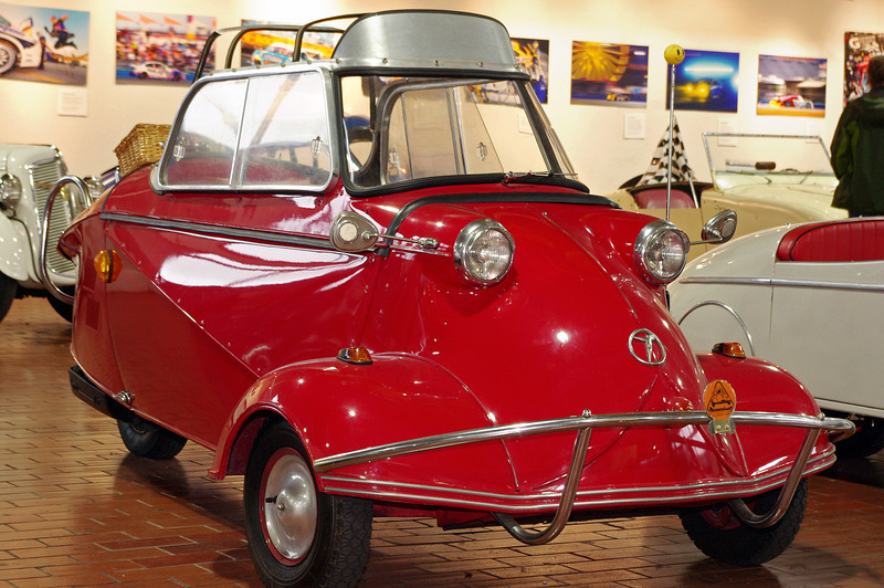 "1957 Messerschmitt KR200; Lane Motor Museum, Nashville, Tennessee. From their website:<br /> ""Although it bears the name of the famous aircraft builder–Willy Messerschmitt–he had little to do with the car's design. Fritz Fend designed the car, and it was built at Messerschmitt's factory which was restricted from building airplanes after World War II. This car appealed to motorcyclists who wanted more weatherproof transportation and to customers who found it cost half the price of a Volkswagen."""