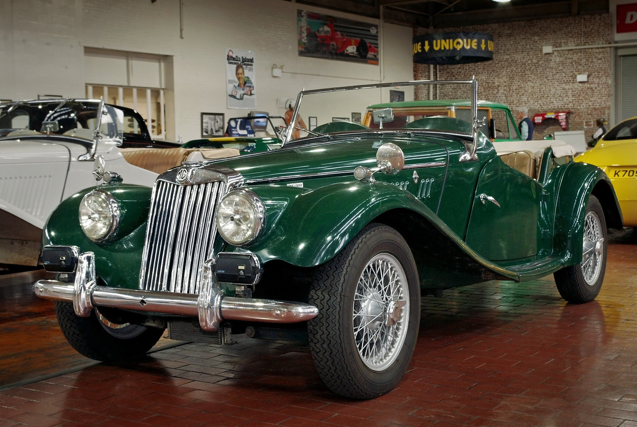 """MG TF 1500 - 1955; Lane Motor Museum, Nashville, Tennessee. From their website:<br /> <br /> """"In 1949, the MG TC gave way to the MG TD; in 1953, the MG TD gave way to the MG TF. The TF was at the time a rather unsuccessful attempt to stall the impatient car enthusiasts who had started to get tired of the long series of the T-type and were crying for something new. Hence, the TF became a short production series before the MGA was released. It was basically a cosmetic modification of the TD but had a more modern look, with a more inclined radiator and built-in head lamps. In hindsight, the TF turned out to be perhaps the most beautiful of all the MG models.""""<br /> <br /> When he was a teenager museum owner Jeff Lane  received this car as a gift from his father - in pieces. Jeff restored it over a period of years and finally took his driver's license road test in it."""