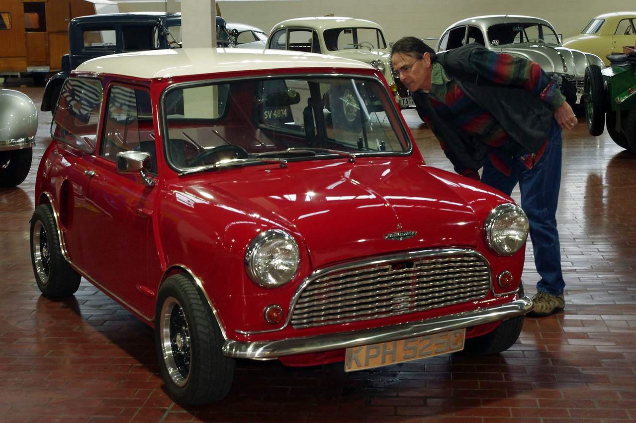 Gary checks out the  Austin Mini at the Lane Motor Museum in Nashville, Tennessee. This is actually a replica of a  1965 car modified by John Cooper. He put two engines in it, front and rear. The car was fast, and well balanced, but an engine failure caused a rollover crash in which Cooper was hurt, and he abandonded the concept.
