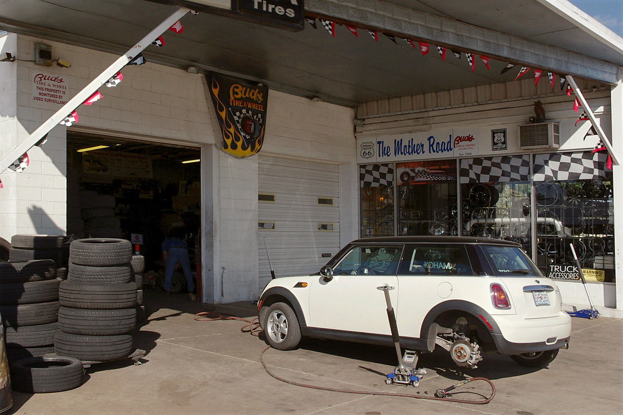 The MINI gets a thorn pulled from its paw at Bud's Tire and Wheel on old Route 66 (College Street), just west of the square, Springfield, Missouri.