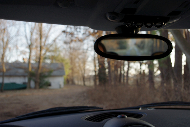 """Driver's view, after installing a 2003 mirror I found on eBay. The difference seen between this 2003 mirror and the 2010 in the previous photo is subtle - but as a driver, I found the older mirror to be a significant improvement. It would block even less of the view if it were mounted a little higher, but now that the mirror no longer is connected to the car by electrical wiring, I can easily remove the whole thing.<br /> <br /> eBay buyers will discover a huge range of """"Buy it now"""" prices for MINI mirrors. Some MINI OEM mirrors included auto-dimming or advanced communication features and they are worth more - but even for the exact same mirror I saw prices ranging from $17 to $90. With shipping, I paid about $26.<br /> <br /> 2009-2010 owners: If you decide to make the switch to the older (smaller) mirror, be prepared to extract the circuit board from the newer mirror and re-locate it in the headliner, or your remote door locks wont work.<br /> <br /> UPDATE: The older series fits the newer mirror mount - kinda. If I had installed the older 2003 and left it alone it might have been OK, but after removing and reinstalling it, something got loose. So, beware - this option may not be that satisfactory. I finally replaced the 2003 MINI mirror with a third party windshield mount - which I like even berter"""