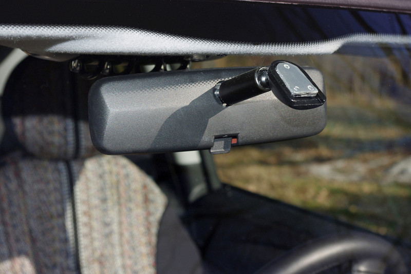 """Windshield-mount rear view mirror, exterior view. This one replaces the factory mirror on my 2010 MINI Cooper (R56), which I felt was too big. <br /> <br /> The aftermarket mirror is the """"Pilot"""" brand, 8"""" - purchased from my local Auto Zone store. The mount must be glued to the glass; it came with a tube of silicone type adhesive. Instead of using the silicone glue, I opted for the 3M brand windshield adhesive."""