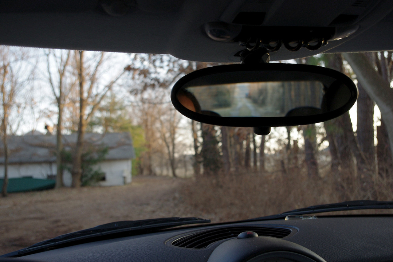 Driver's view, stock mirror, on my 2010 base model MINI Cooper hardtop (R56).<br /> <br /> Use the right arrow on your keyboard to compare the 2010 mirror to the smaller 2003 pictured next.