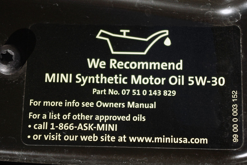 """This decal is found under my hood, and here MINI has provided the short answer - this is all you need to know if you have a MINI dealer nearby.<br /> <br /> But for me, it's over 200 miles to the nearest MINI dealer - so I'm thinking there has got to be something on the shelves of my local automotive store that will work just as good as the factory oil, right? <br /> <br /> It says here: """"See the Owner's Manual"""" - so let's take a look."""