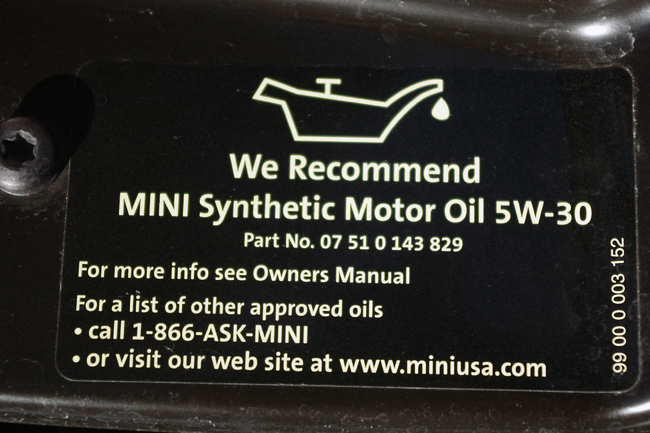 "This decal is found under my hood, and here MINI has provided the short answer - this is all you need to know if you have a MINI dealer nearby.<br /> <br /> But for me, it's over 200 miles to the nearest MINI dealer - so I'm thinking there has got to be something on the shelves of my local automotive store that will work just as good as the factory oil, right? <br /> <br /> It says here: ""See the Owner's Manual"" - so let's take a look."