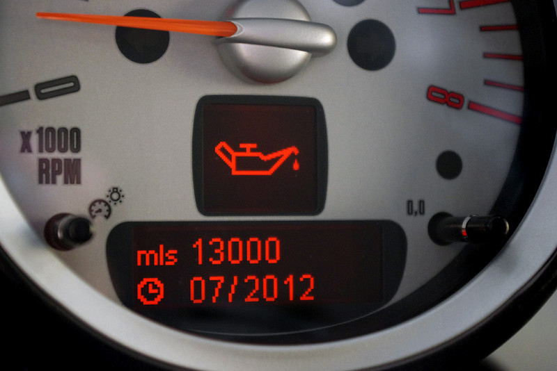 """Jan. 2011 About 4k on the odometer.<br /> <br /> Here is my MINI's obc, telling me my first oil change is not due for another 13,000 miles, or almost 2 years after purchase!<br /> <br /> Yes, I know, as a new MINI Cooper owner, I get free scheduled maintenance for 3 years, including free oil changes - but only according to MINI's """"Conditions Based Service."""" That is, the on board computer (obc) decides when I need my first oil change, based on my actual driving history.<br /> <br /> And yes, I also know it's a new era of automotive engineering, and the ancient oil lore of old that was passed down to us from our fathers is as out of date as 8 track tapes. But some of us are having trouble letting go, and a 17,000 mile oil change seems as unnatural to me as itty bitty dogs, incest, or raspberry wheat beer.<br /> <br /> The conspiracy theory goes something like this: Marketing wants the car to be low maintenance to make it easier to sell, so they demand long oil change intervals. Plus, MINI is doing the scheduled maintenance at no charge, so they want to do as few as possible - and they only care if the engine lasts until your warranty is up. <br /> <br /> For whatever reason, I plan to do my first oil change at home, well in advance of 17,000 miles - say around 5-6k miles. But what am I going to change it to?"""