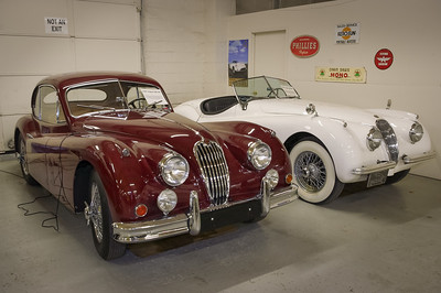 A couple of sweet Jaguars. In front, a maroon1957 Jaguar XK140, and a white 1954 Jaguar XK120. Was a private collection, now the Route 66 Car Museum.