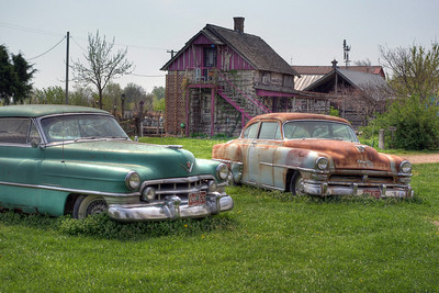 The Cadillac is from around 1950 or 51, and the Chrysler was new in about 1952 or 53. Red Oak, Missouri. HDR processing with Detail Enhancer.