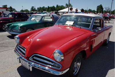 I didn't get the model specifics in my notes, but these appear to be Studebaker Champions from about 1953-54.  47th Annual Studebaker Drivers Club Meet, Springfield, MO. June 23, 2011.